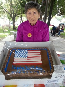 "Corresponding Secretary Mollie ""Lee"" Welinsky shows off the Independence Day cake"