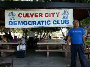 CCDC President Bill Wynn stands next to the club's official banner